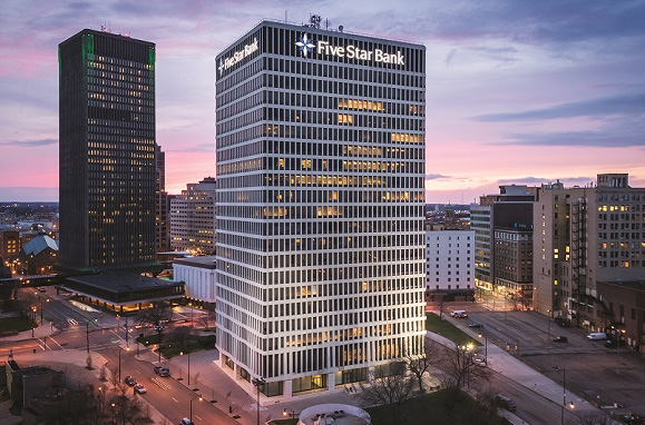 Five Star Bank Plaza in downtown Rochester at sunset.